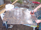 Cleaning the surface rust from the sheet metal.