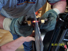 Spot welding the attachment edges to the wire pass through panel.